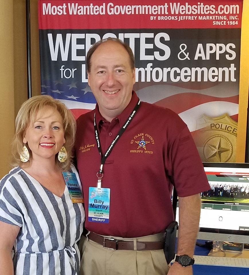 Renea and Sheriff Murray at Most Wanted Booth