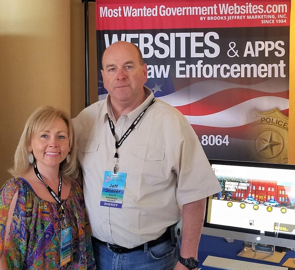 Renea and Sheriff Shaver at booth